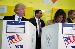 Republican presidential nominee Donald Trump and his wife Melania Trump vote at PS 59 in New York, New York, U.S. November 8, 2016. REUTERS/Carlo Allegri TPX IMAGES OF THE DAY - RTX2SKKG